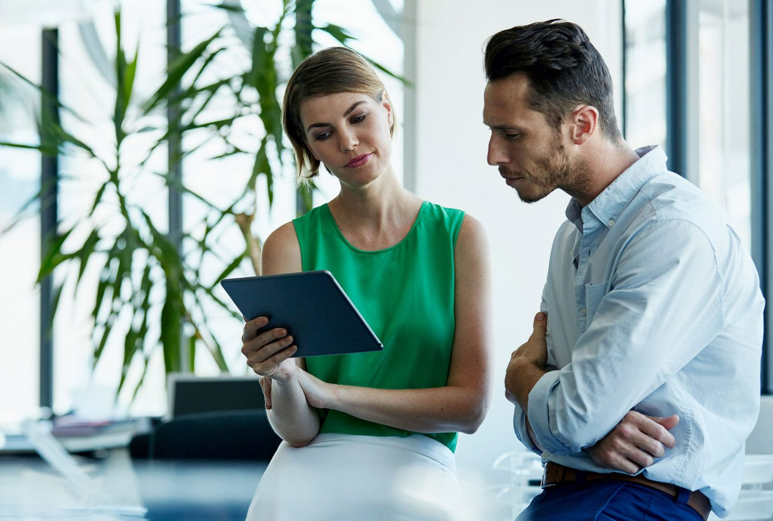 Woman and Man Talking iPad Northdoor PLC